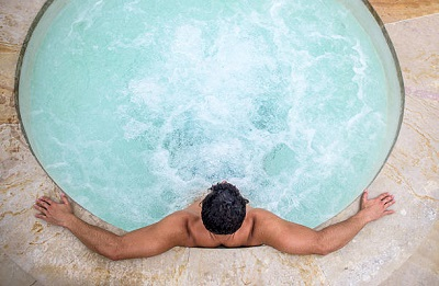man relax in hot tubs